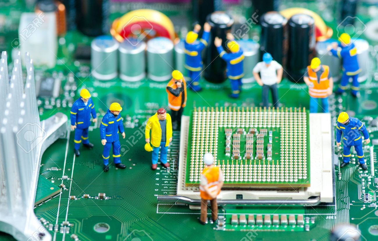 13646683-group-of-miniature-engineers-inspecting-computer-processor