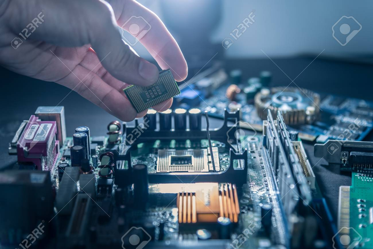 93717860-the-technician-is-putting-the-cpu-on-the-socket-of-the-computer-motherboard-